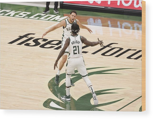Playoffs Wood Print featuring the photograph Bryn Forbes and Jrue Holiday by Kamil Krzaczynski