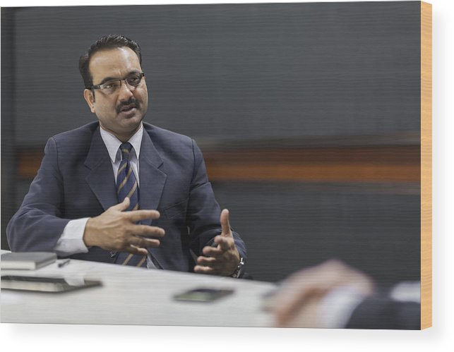 Corporate Business Wood Print featuring the photograph Businessman explaining idea in office meeting by Shannon Fagan