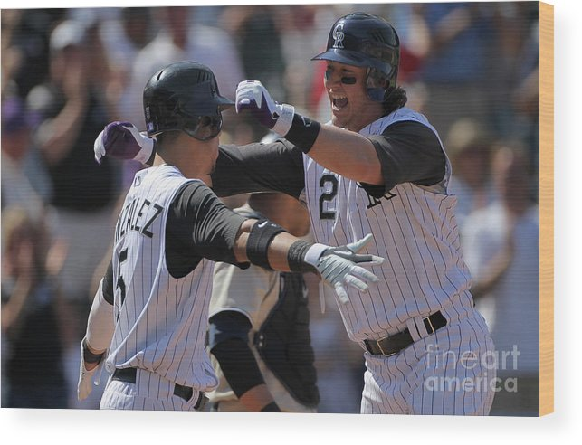 Scoring Wood Print featuring the photograph Carlos Gonzalez and Troy Tulowitzki by Doug Pensinger