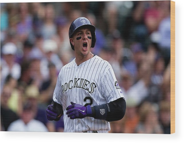 Scoring Wood Print featuring the photograph Carlos Gonzalez and Troy Tulowitzki by Justin Edmonds