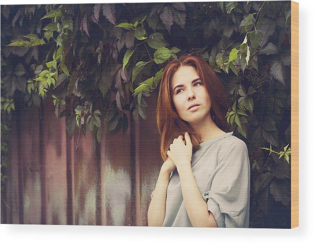 People Wood Print featuring the photograph Caucasian woman standing under leaves by fence by Maxim Chuvashov