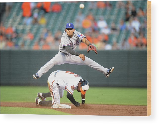 American League Baseball Wood Print featuring the photograph Chris Davis, Rougned Odor, and Adam Jones by Mitchell Layton