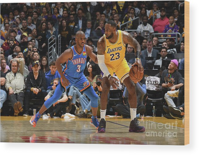 Nba Pro Basketball Wood Print featuring the photograph Chris Paul and Lebron James by Andrew D. Bernstein