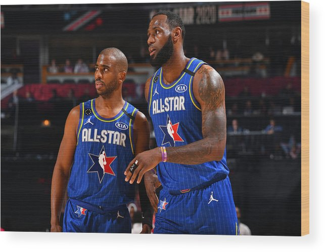 Nba Pro Basketball Wood Print featuring the photograph Chris Paul and Lebron James by Jesse D. Garrabrant