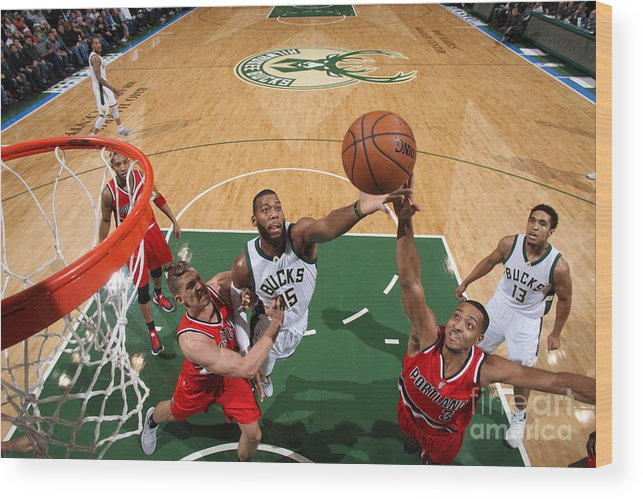 Nba Pro Basketball Wood Print featuring the photograph C.j. Mccollum and Greg Monroe by Gary Dineen