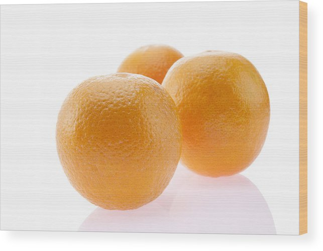 White Background Wood Print featuring the photograph Close-up of oranges by IndiaPix/IndiaPicture