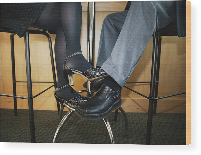 Heterosexual Couple Wood Print featuring the photograph Couple Playing Footsie Under the Table by Kelly Redinger