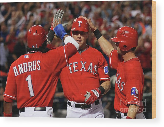 Playoffs Wood Print featuring the photograph Elvis Andrus, Michael Young, and Josh Hamilton by Stephen Dunn