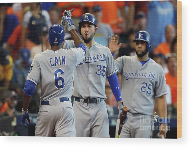 Three Quarter Length Wood Print featuring the photograph Eric Hosmer and Lorenzo Cain by Bob Levey