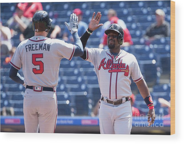 Three Quarter Length Wood Print featuring the photograph Freddie Freeman And Brandon Phillips by Mitchell Leff