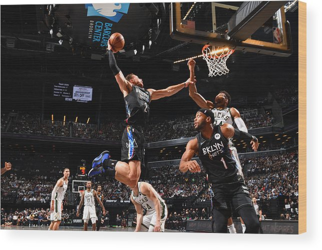 Nba Pro Basketball Wood Print featuring the photograph Giannis Antetokounmpo and Blake Griffin by Jesse D. Garrabrant