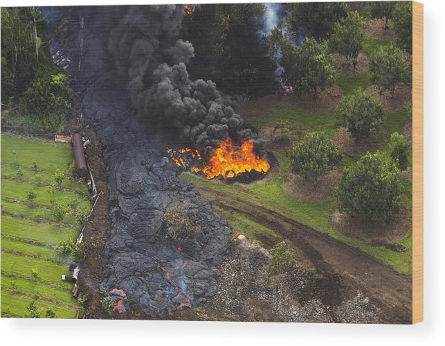 Hawaii Volcanoes National Park Wood Print featuring the photograph Homes In Pahoa, Hawaii Threatened By Lava Flow From Kilauea Volcano by Andrew Richard Hara