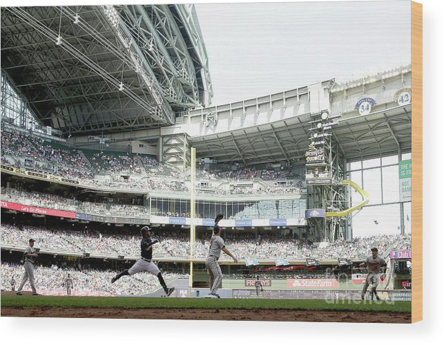 Joe Mauer Wood Print featuring the photograph Joe Mauer and Jean Segura by Mike Mcginnis