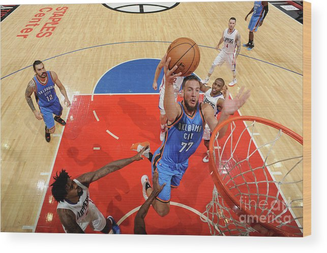 Nba Pro Basketball Wood Print featuring the photograph Joffrey Lauvergne by Juan Ocampo