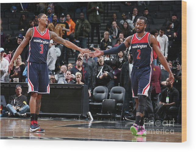 Nba Pro Basketball Wood Print featuring the photograph John Wall and Bradley Beal by Nathaniel S. Butler