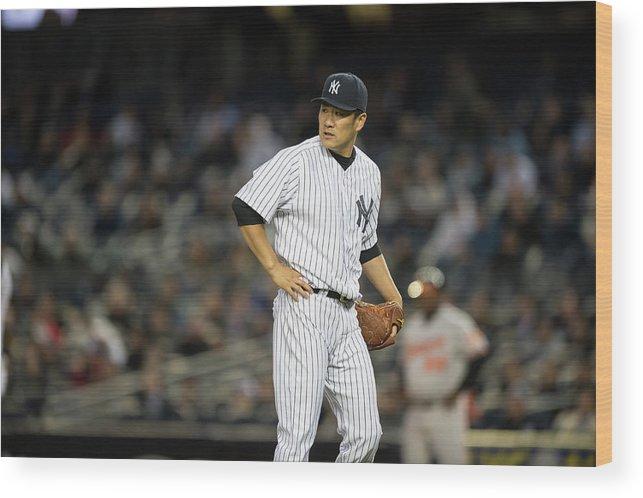 American League Baseball Wood Print featuring the photograph Jonathan Schoop and Masahiro Tanaka by Rob Tringali