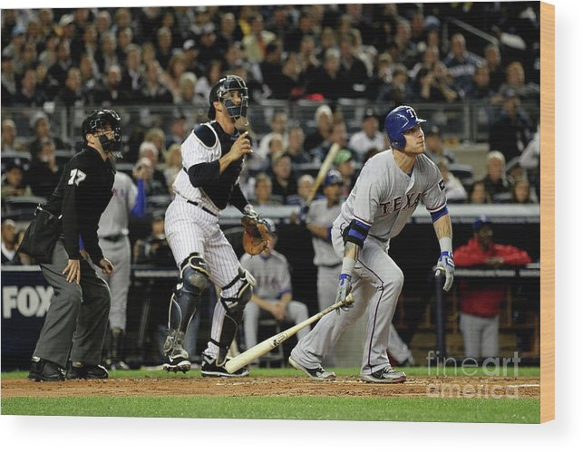 Playoffs Wood Print featuring the photograph Josh Hamilton and Jorge Posada by Al Bello
