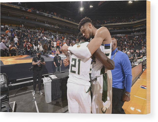 Playoffs Wood Print featuring the photograph Jrue Holiday and Giannis Antetokounmpo by Andrew D. Bernstein