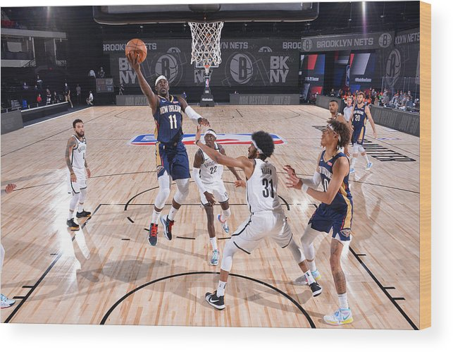 Nba Pro Basketball Wood Print featuring the photograph Jrue Holiday by Jesse D. Garrabrant