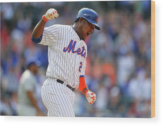 Three Quarter Length Wood Print featuring the photograph Juan Uribe by Mike Stobe
