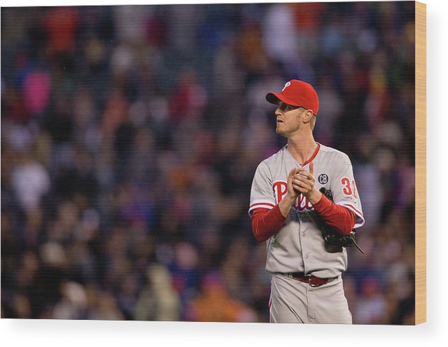 Defeat Wood Print featuring the photograph Justin Morneau and Kyle Kendrick by Justin Edmonds