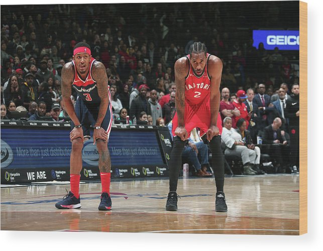 Nba Pro Basketball Wood Print featuring the photograph Kawhi Leonard and Bradley Beal by Ned Dishman