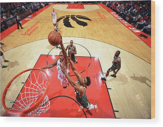 Playoffs Wood Print featuring the photograph Kawhi Leonard and Giannis Antetokounmpo by Jesse D. Garrabrant