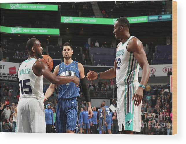 Kemba Walker Wood Print featuring the photograph Kemba Walker and Dwight Howard by Kent Smith