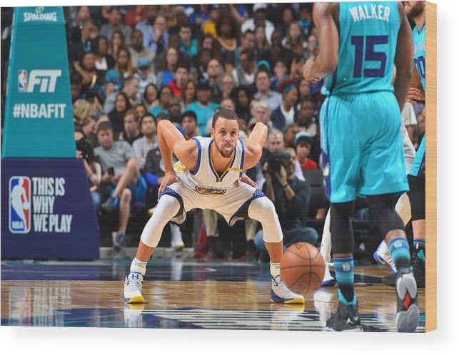 Kemba Walker Wood Print featuring the photograph Kemba Walker and Stephen Curry by Jesse D. Garrabrant