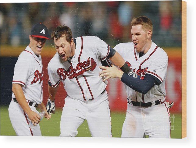Atlanta Wood Print featuring the photograph Kris Medlen, Freddie Freeman, and Chris Johnson by Kevin C. Cox