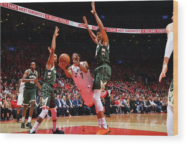 Playoffs Wood Print featuring the photograph Kyle Lowry and Giannis Antetokounmpo by Jesse D. Garrabrant
