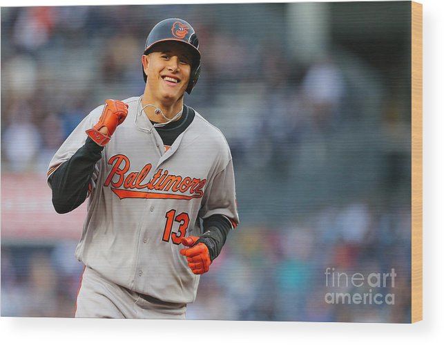 Three Quarter Length Wood Print featuring the photograph Manny Machado and Matt Wieters by Mike Stobe