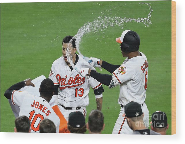 People Wood Print featuring the photograph Manny Machado, Jonathan Schoop, and Adam Jones by Rob Carr