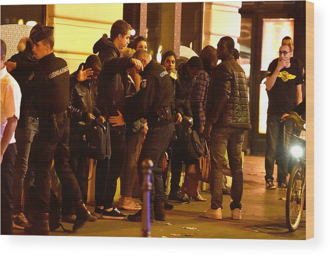 November 2015 Paris Attacks Wood Print featuring the photograph Many Dead After Multiple Shootings In Paris by Pascal Le Segretain