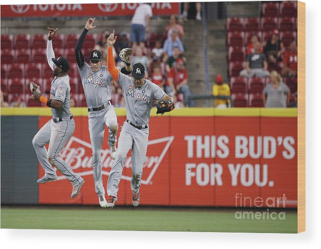 Great American Ball Park Wood Print featuring the photograph Marcell Ozuna, Christian Yelich, and Giancarlo Stanton by Joe Robbins