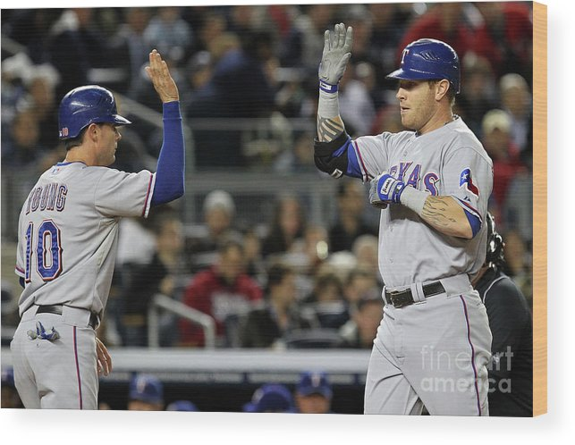 Playoffs Wood Print featuring the photograph Michael Young and Josh Hamilton by Al Bello