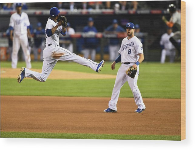 Playoffs Wood Print featuring the photograph Mike Moustakas and Alcides Escobar by Rob Tringali
