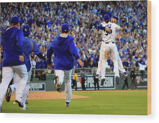 American League Baseball Wood Print featuring the photograph Mike Moustakas and Eric Hosmer by Jamie Squire