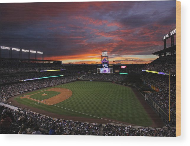 Spectrum Wood Print featuring the photograph Milwaukee Brewers v Colorado Rockies by Doug Pensinger