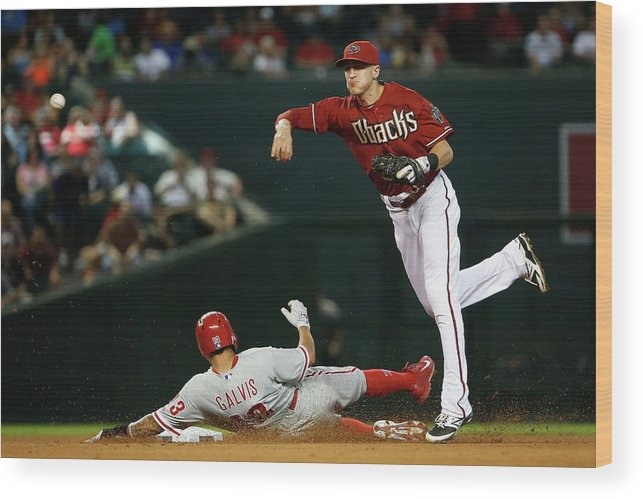 Double Play Wood Print featuring the photograph Nick Ahmed and Freddy Galvis by Christian Petersen
