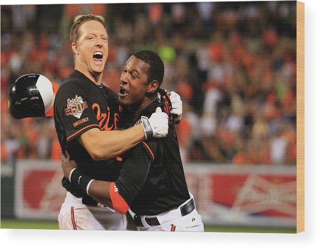 American League Baseball Wood Print featuring the photograph Nick Hundley and Adam Jones by Rob Carr