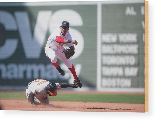 East Wood Print featuring the photograph Nick Markakis, Jonathan Herrera, and Xander Bogaerts by Rob Tringali