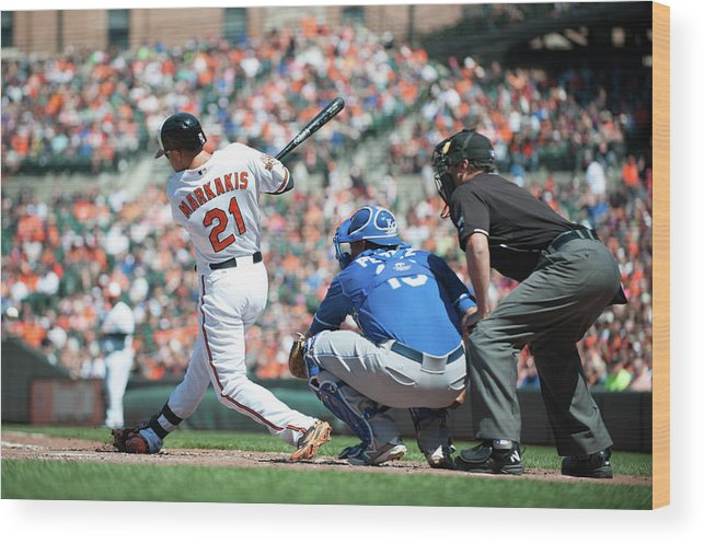 American League Baseball Wood Print featuring the photograph Nick Markakis by Rob Tringali