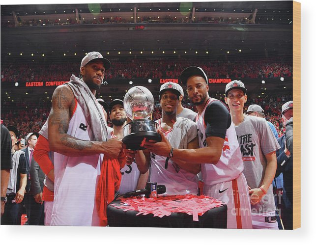 Nba Pro Basketball Wood Print featuring the photograph Norman Powell, Kawhi Leonard, and Kyle Lowry by Jesse D. Garrabrant