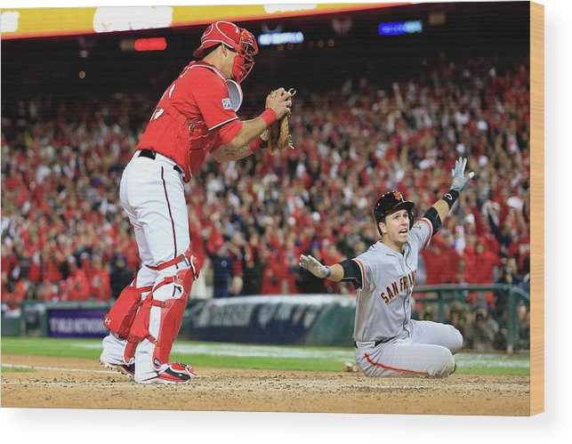 Game Two Wood Print featuring the photograph Pablo Sandoval, Wilson Ramos, And Buster Posey by Rob Carr