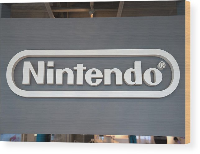 Corporate Business Wood Print featuring the photograph Product Displays Inside The Nintendo Game Front Showroom by Bloomberg