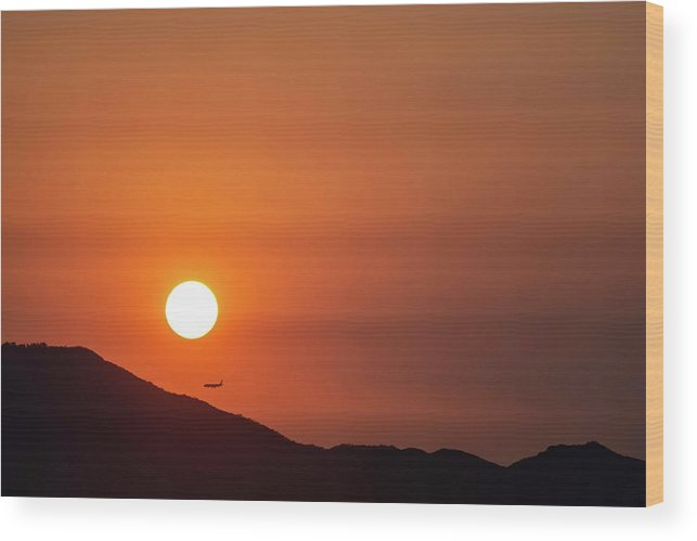 Sunset Wood Print featuring the photograph Red sunset and plane in flight by Hannes Roeckel