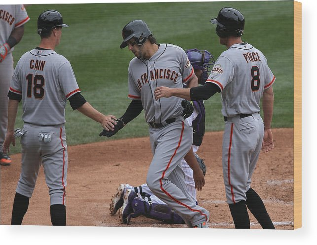 Mike Morse Wood Print featuring the photograph San Francisco Giants v Colorado Rockies by Doug Pensinger