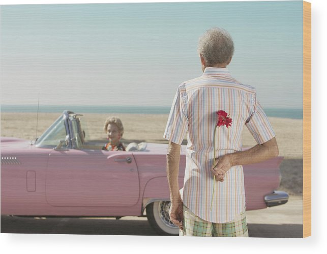 Hiding Wood Print featuring the photograph Senior man surprising wife with flower by ER Productions Limited