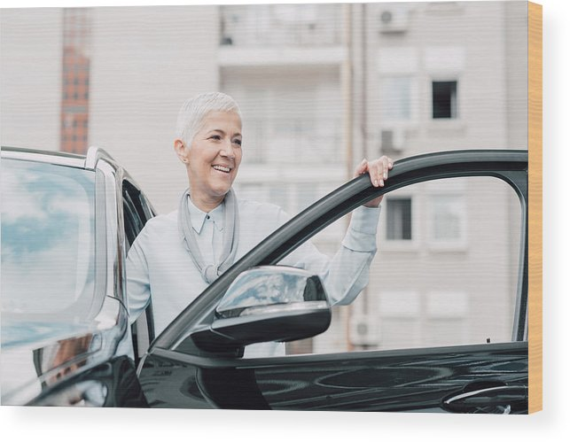 Corporate Business Wood Print featuring the photograph Senior Woman Smiling While Entering A Car by RgStudio